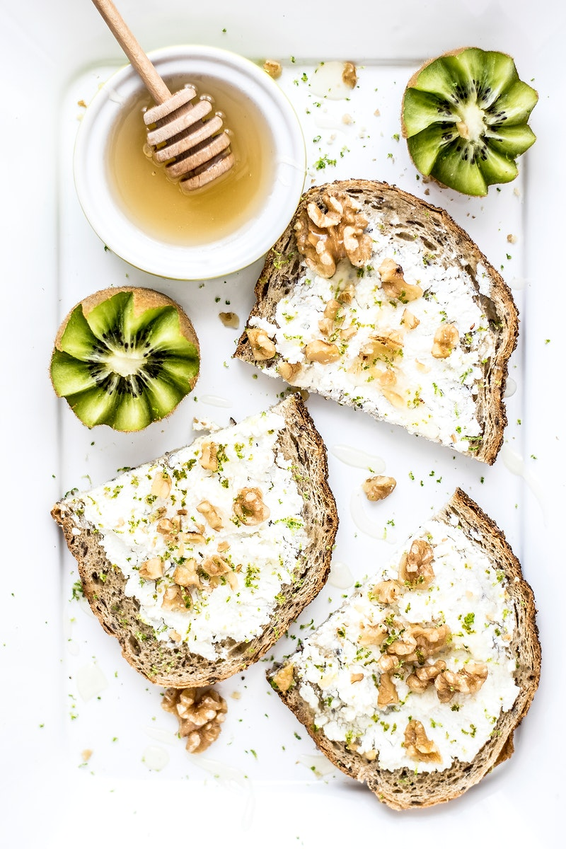Bread with goat cheese honey and walnuts. Visit Monika Grabkowska to see more of her food photography.