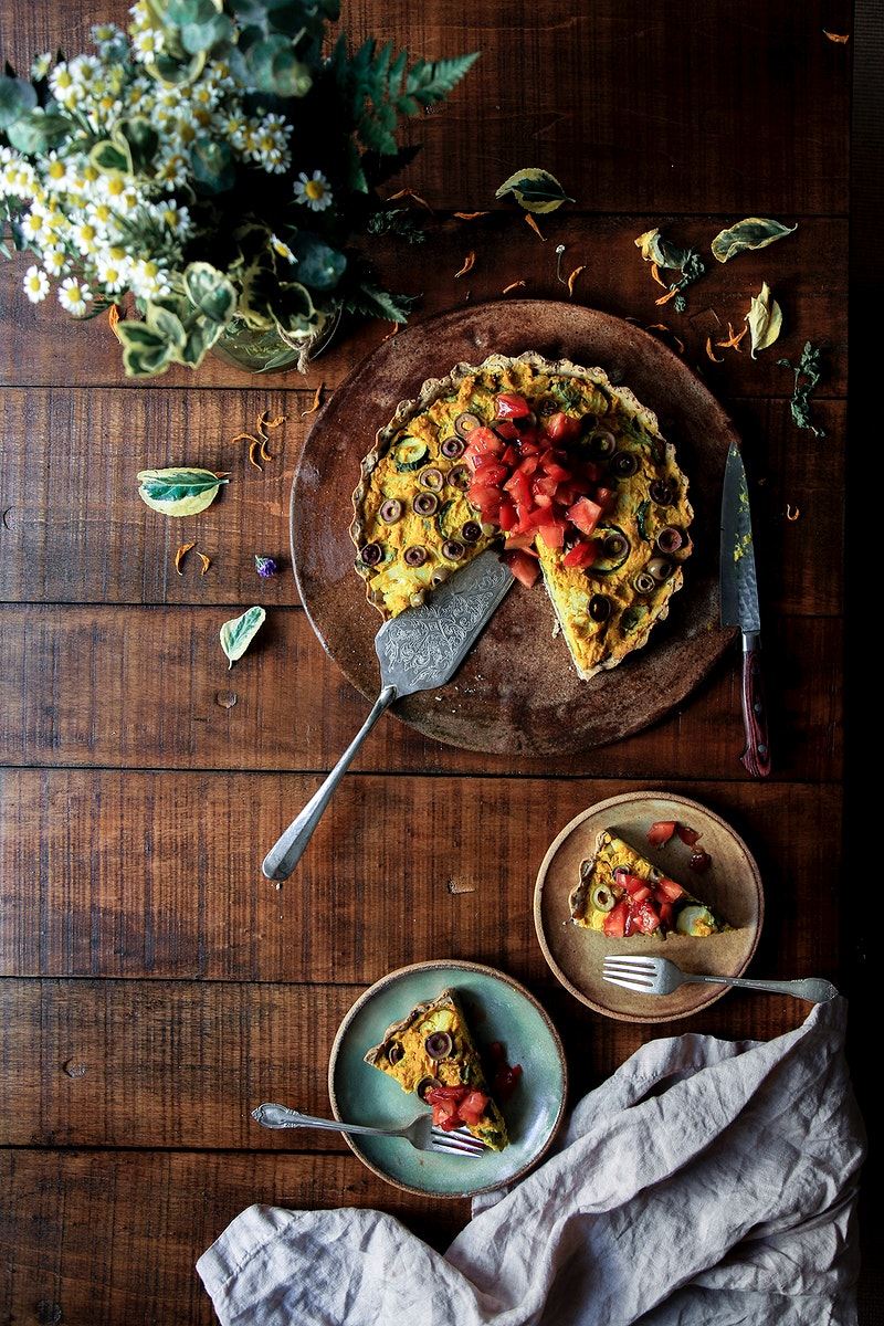 Vegan quiche with diced tomato toppings