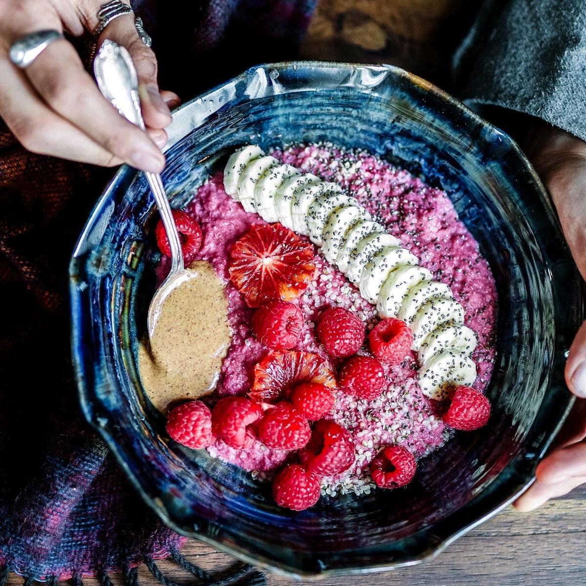 A healthy bowl of beetroot cinnamon porridge infused with maca