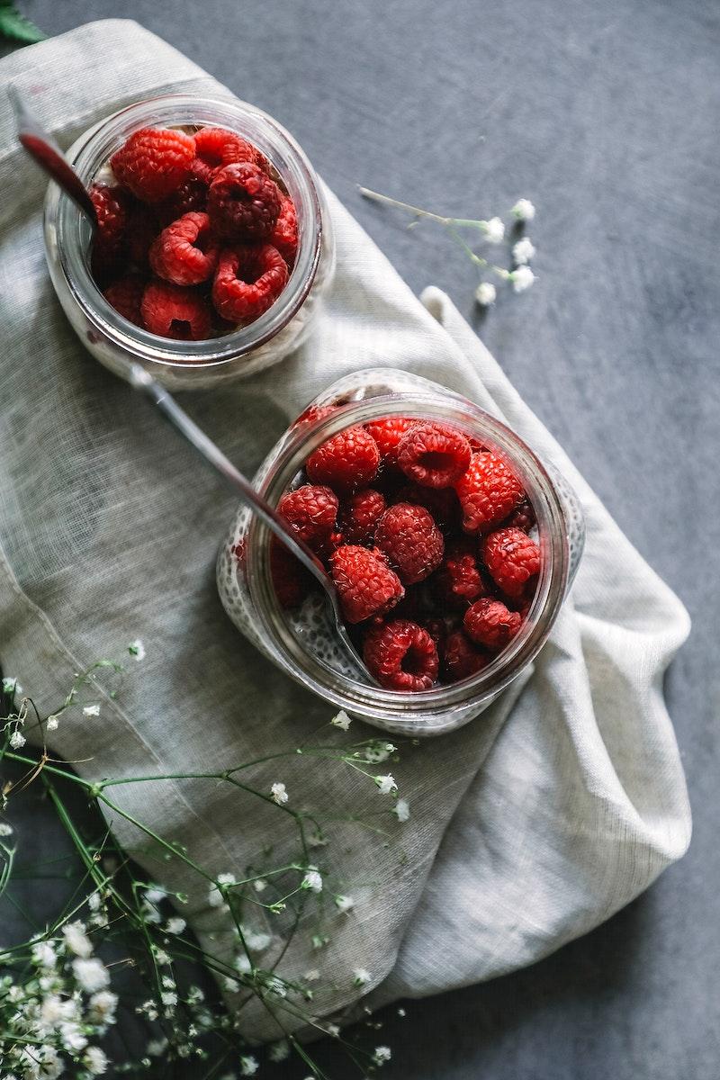 Fresh raspberry in jars
