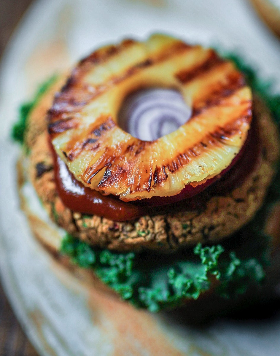 Plant-based burger with fried pineapple on top