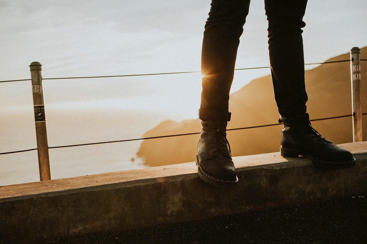 Man standing on a bridge