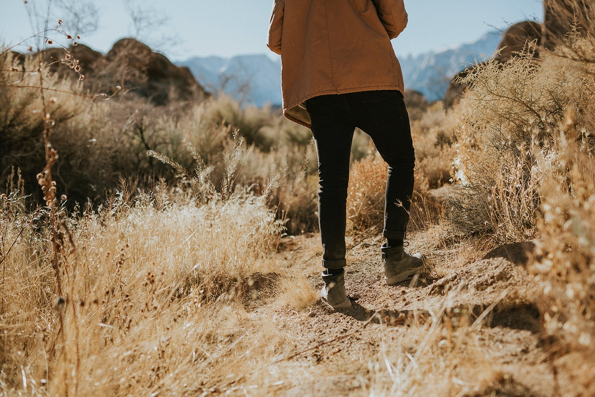 Man hiking on a hill in California