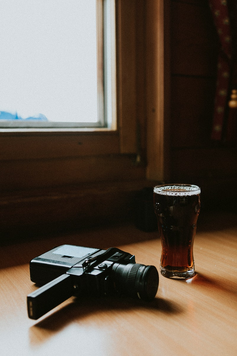 A glass of beer and a retro video camera