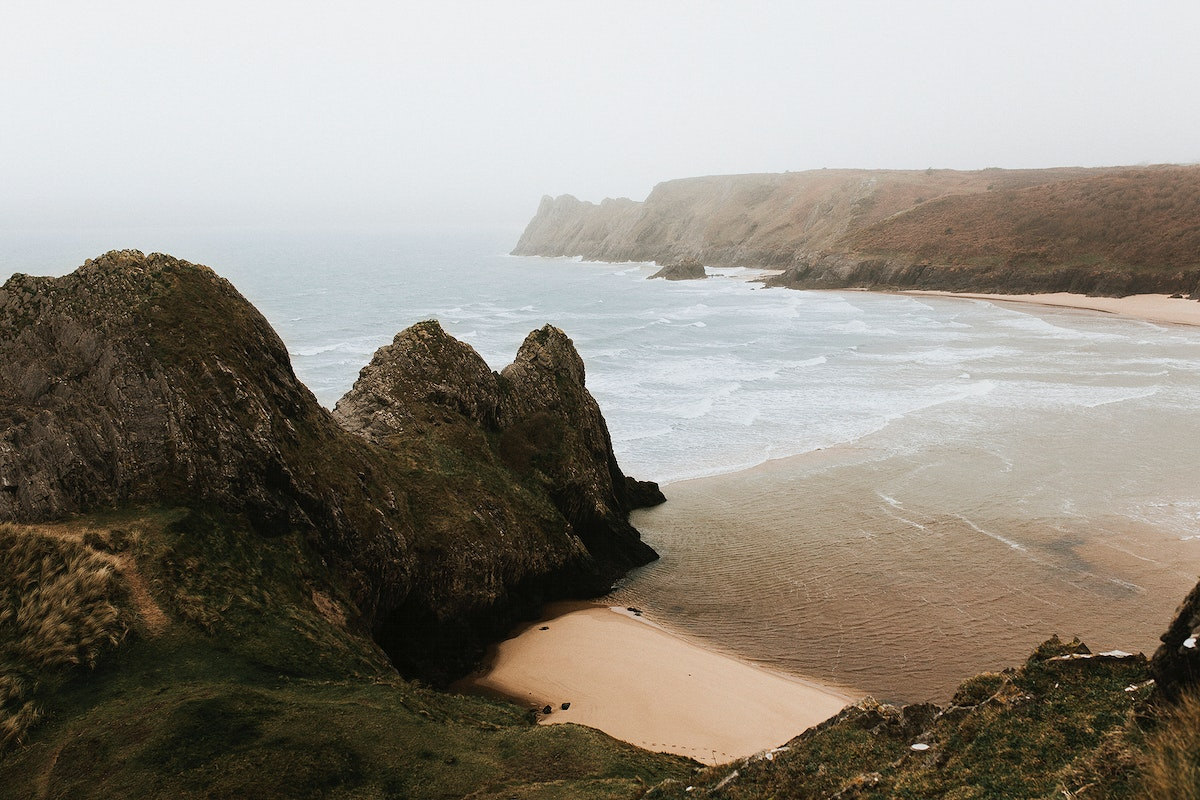 View of Three Cliff Bay in the mist, United Kingdom