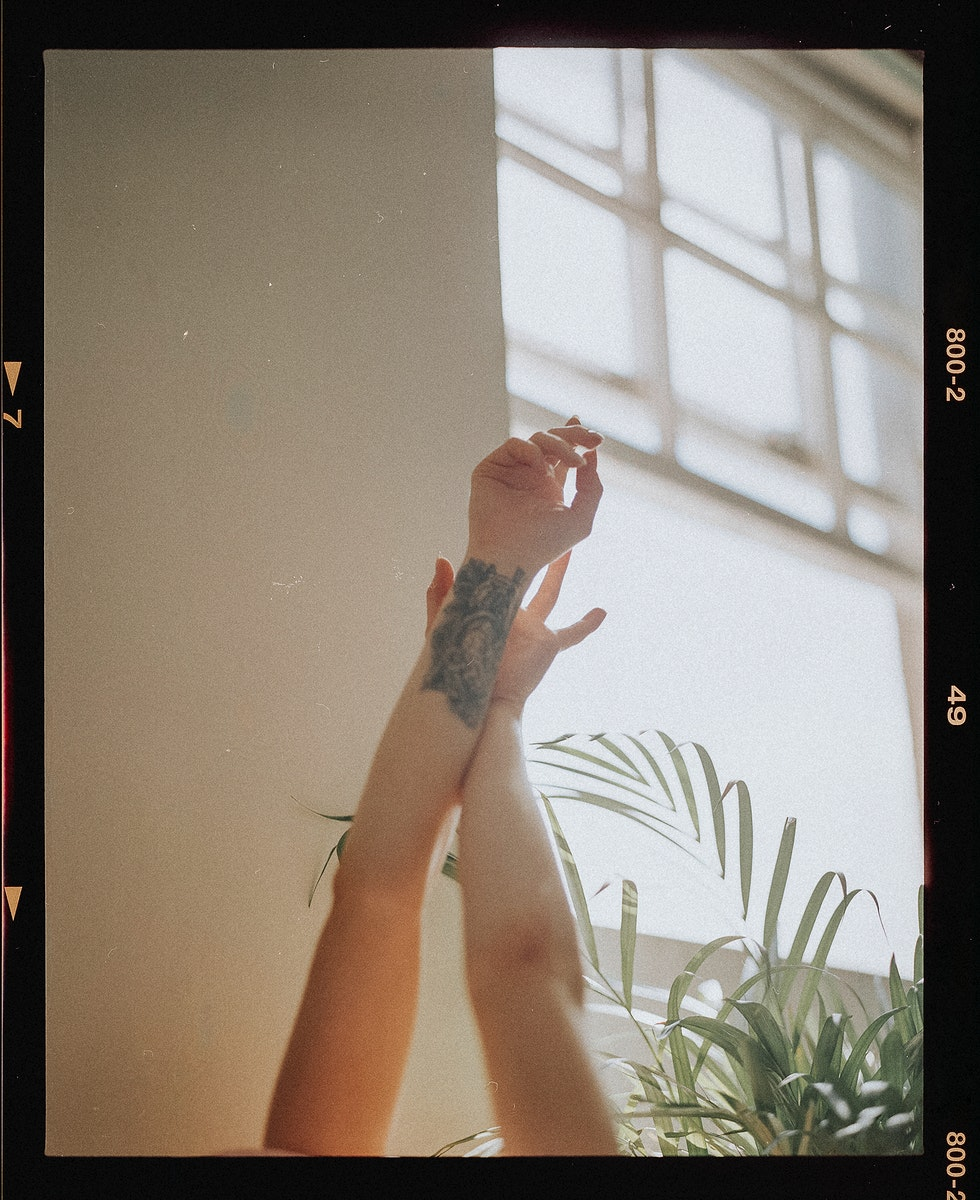 Woman stretching up her arms in the morning