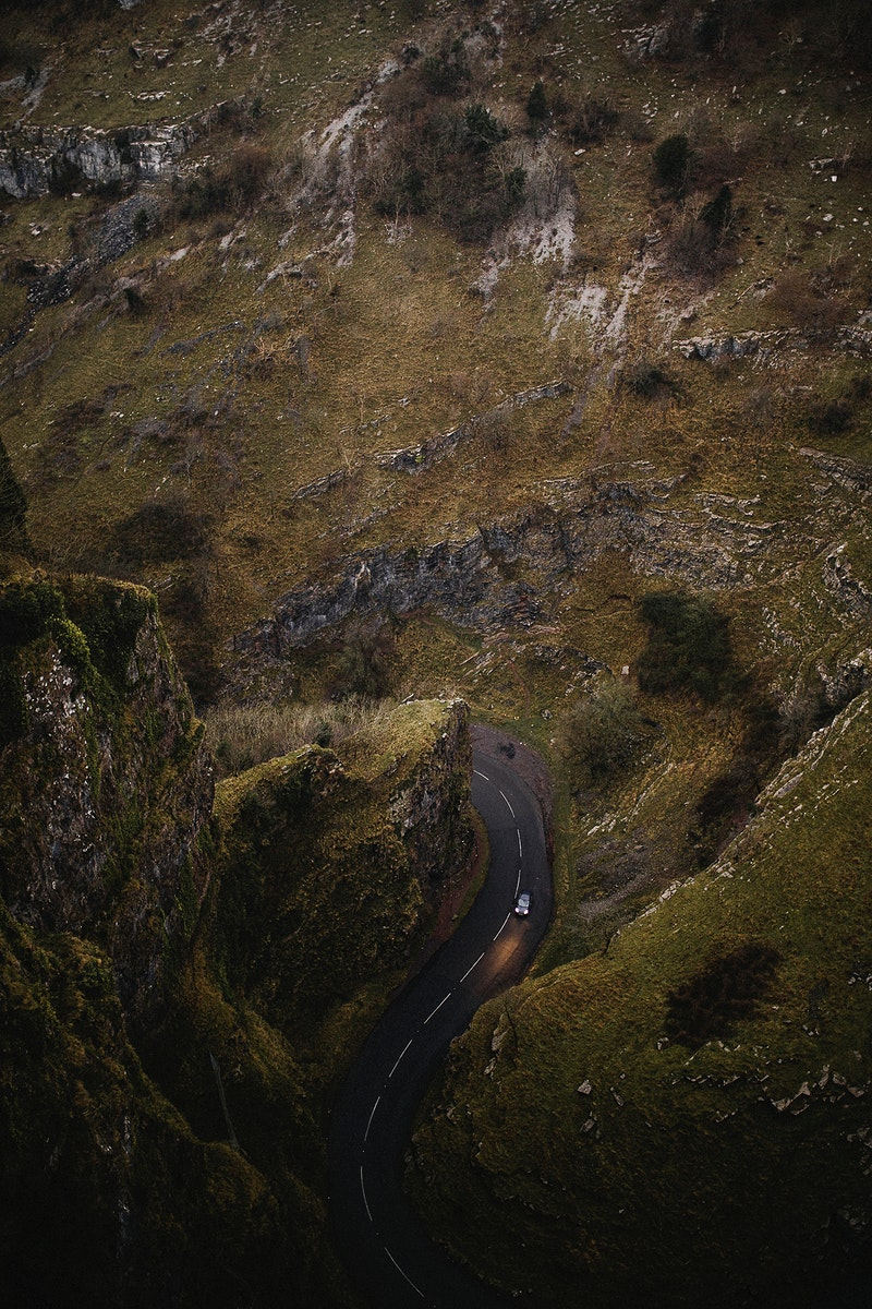 Aerial view of a curvy road and steep cliffs in Cheddar Gorge, England
