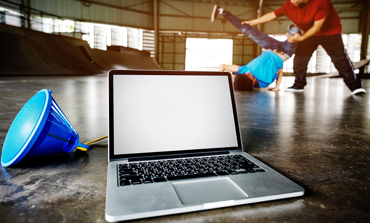 Laptop with an empty screen playing music for breakdancers