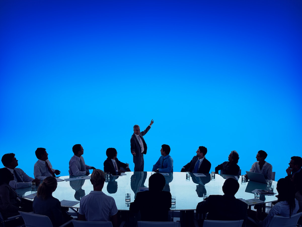 Silhouette of business people in a meeting and copyspace