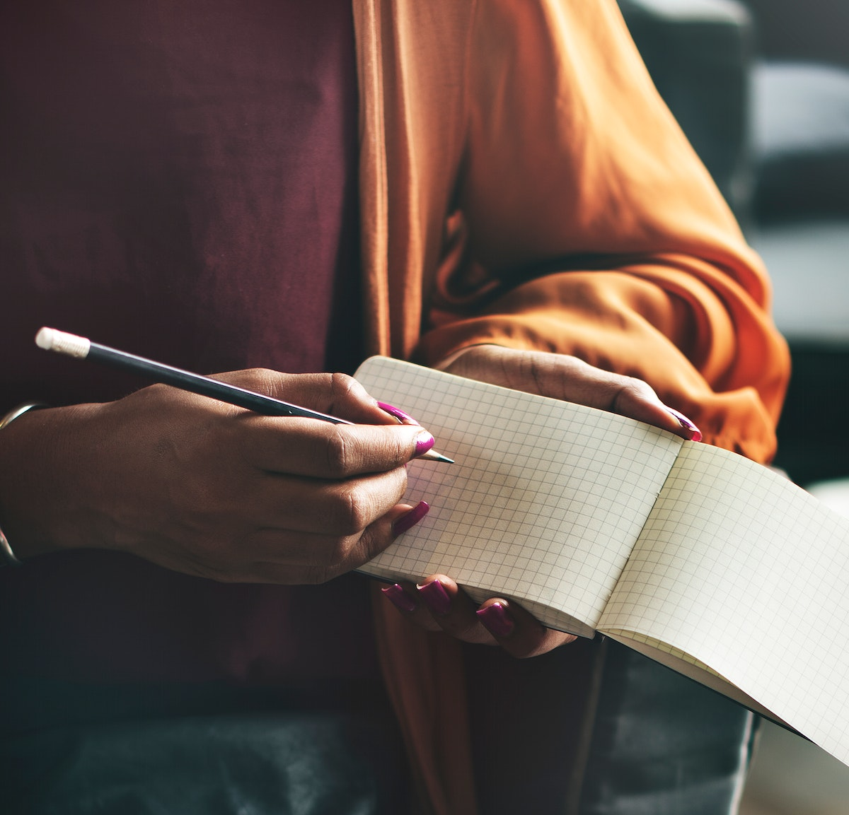 Woman writing down on an empty notepad