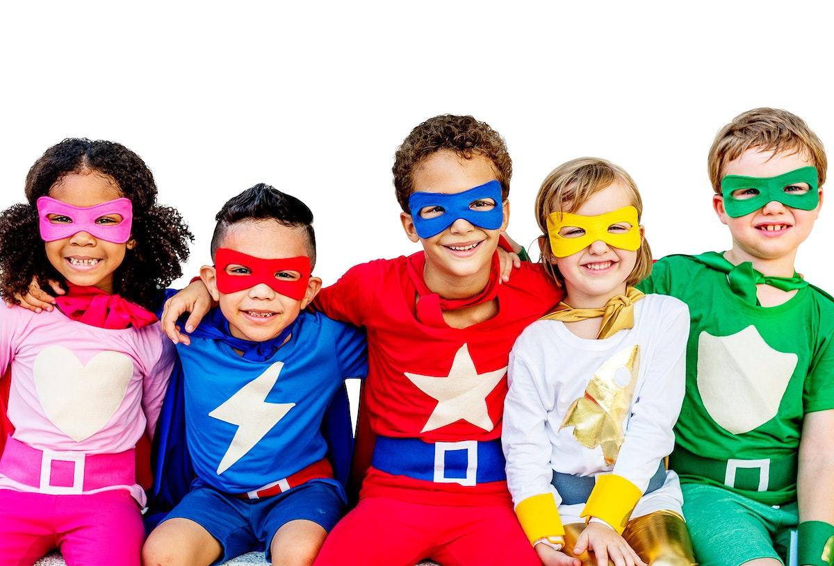 Smiling kids in colorful superhero costumes