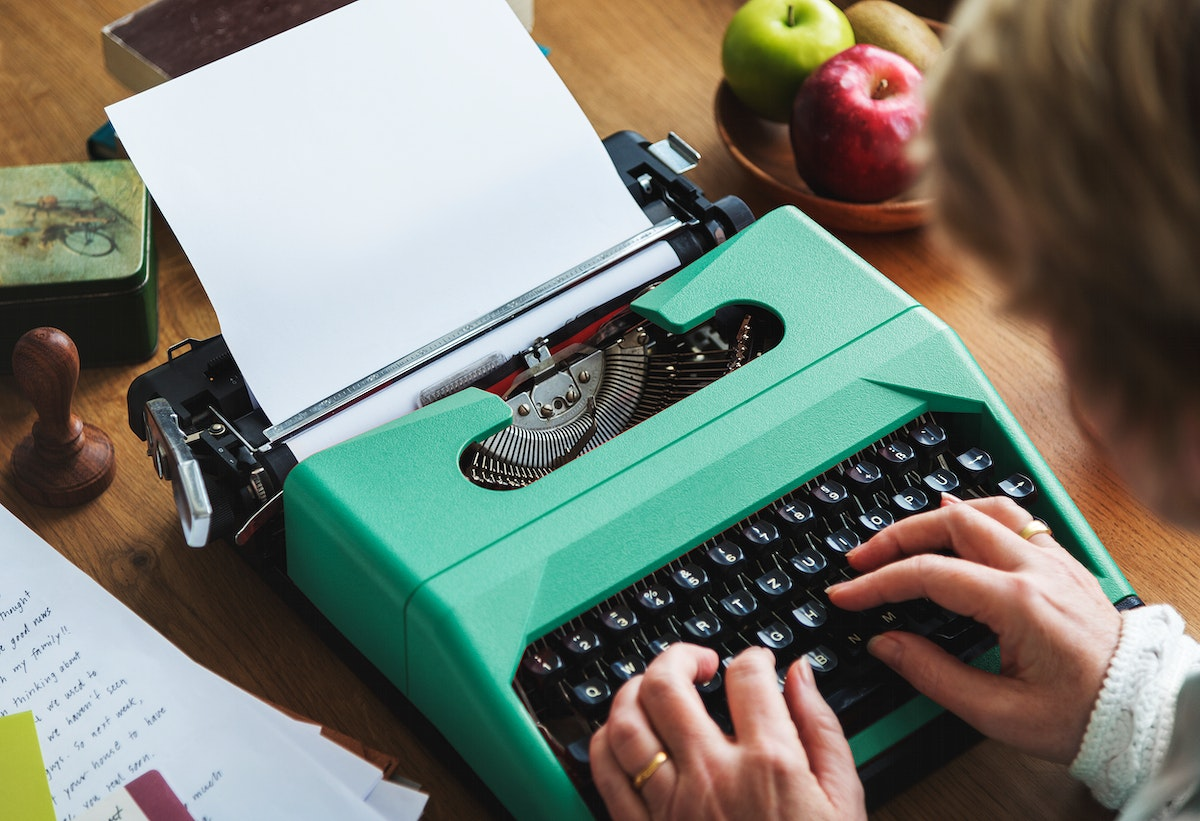 Hands typing on the typewriter