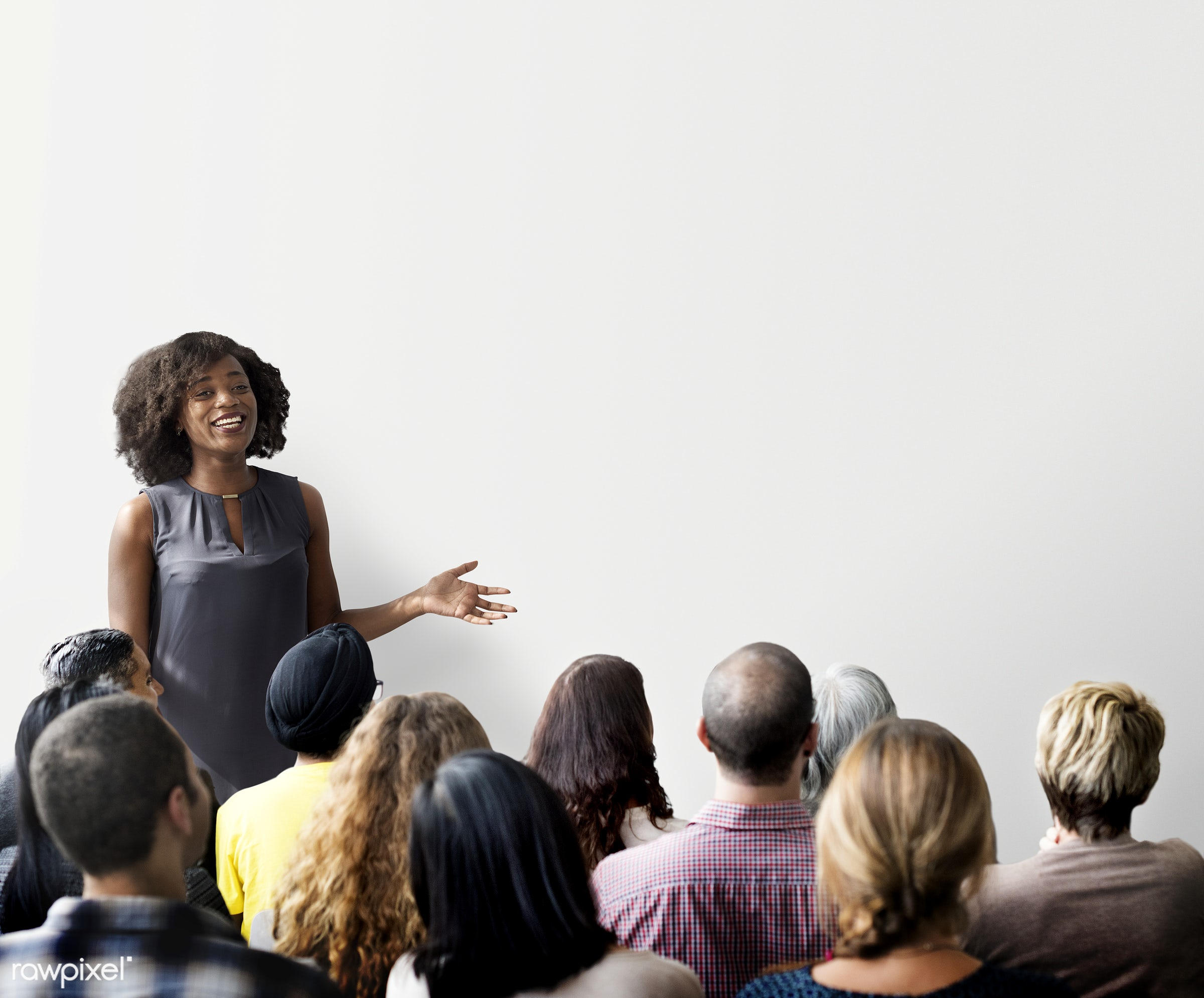 Woman giving a seminar and a copyspace - african, african american, african descent, african woman, asian, asian ethnicity,...