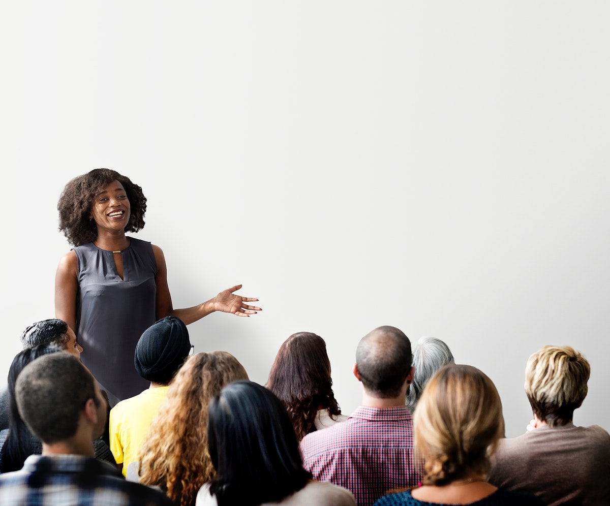 Woman giving a seminar and a copyspace