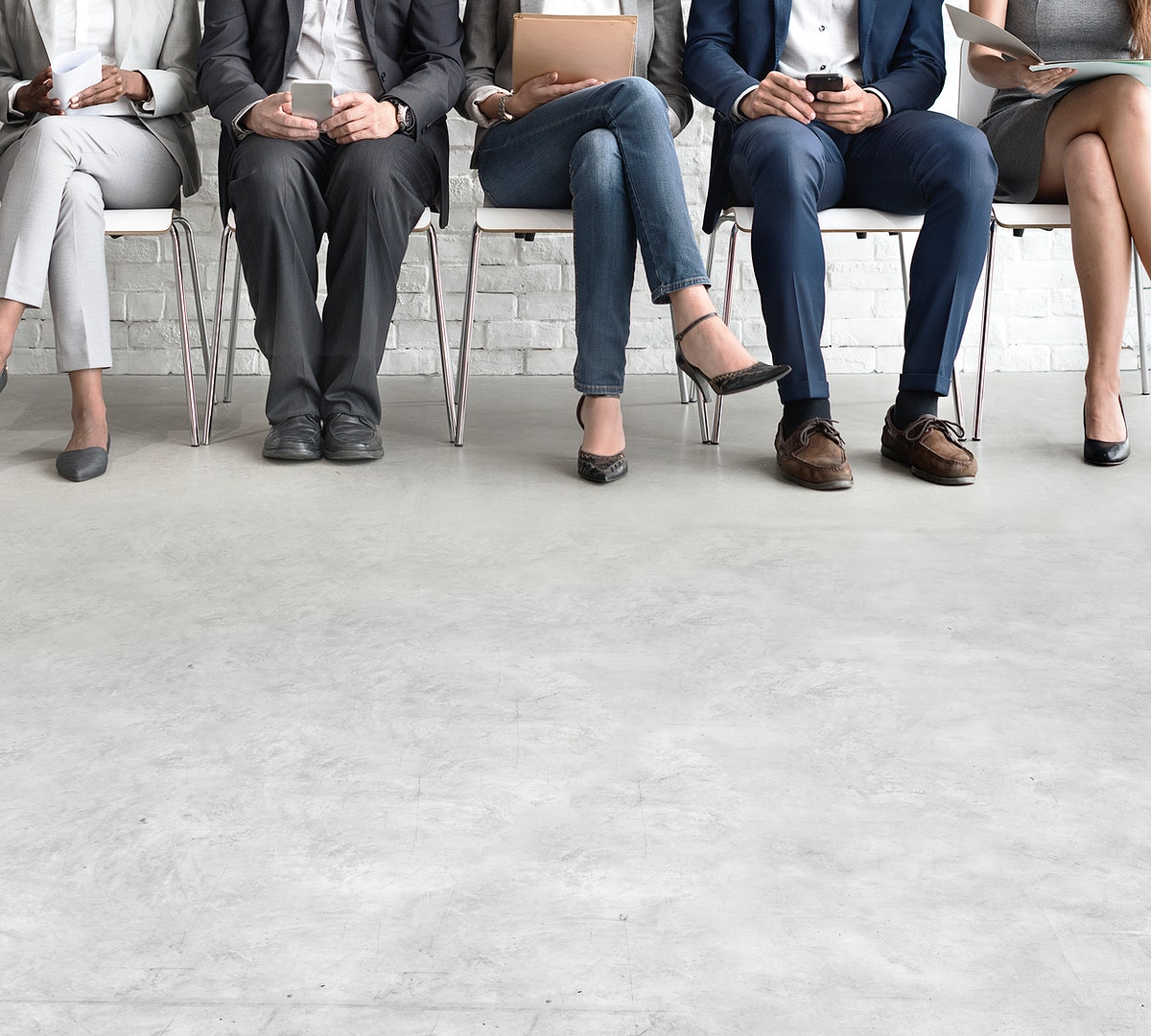 Floor copy space with business people sitting in a row