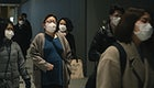 Commuters wearing disposable masks hoping to prevent the spread of corona virus (COVID-19) on February 27th, 2020. Yokohama, Japan.