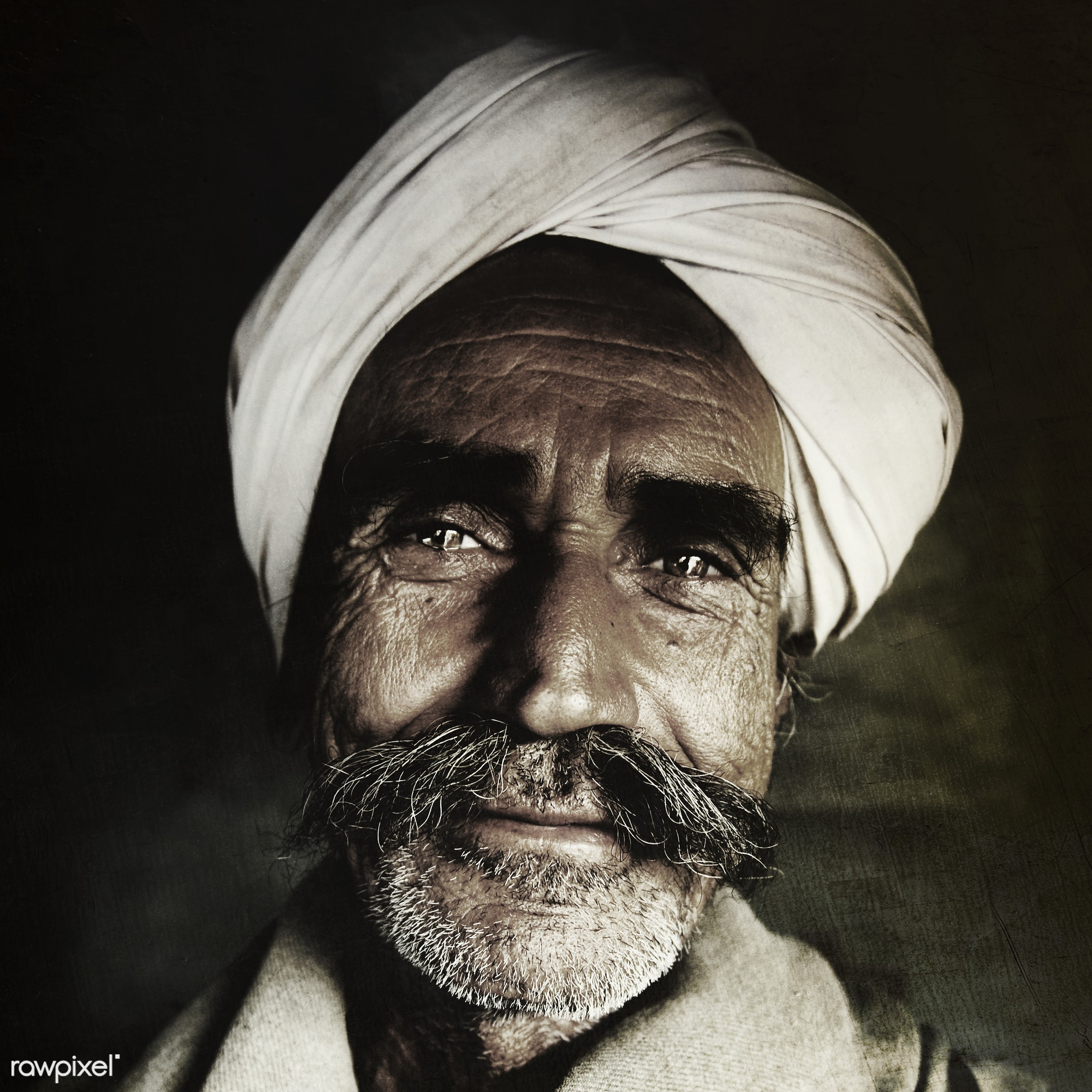 Indigenous senior Indian man looking at the camera. - carrying on the head, close-up, concepts, despair, farmer, grumpy,...