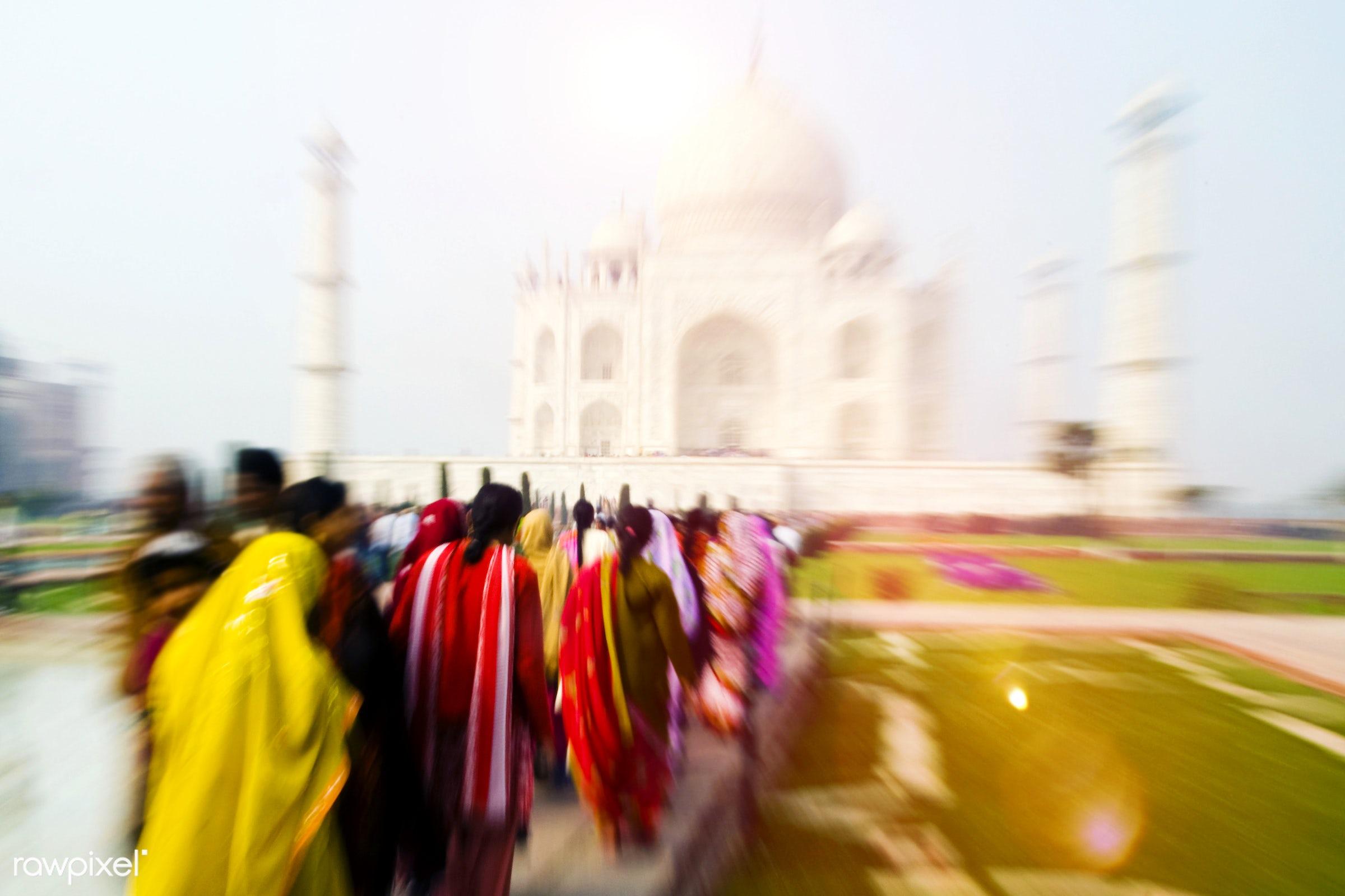People walking through the Taj Mahal. - 7 wonders, architectural styles, architecture, architecture and buildings, asia,...