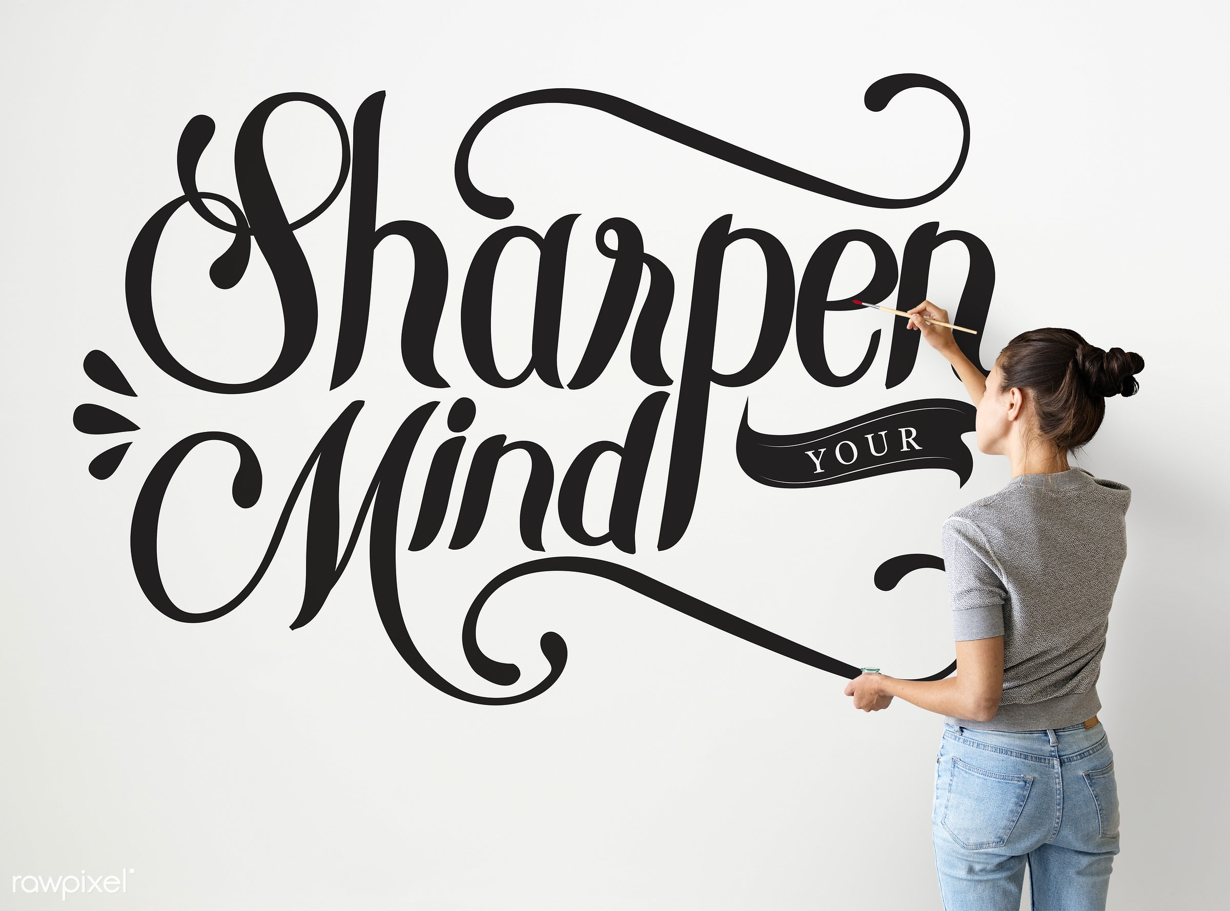 Female artist writing sharpen your mind quote on the wall - alone, american, artist, artwork, attitude, back, brush,...