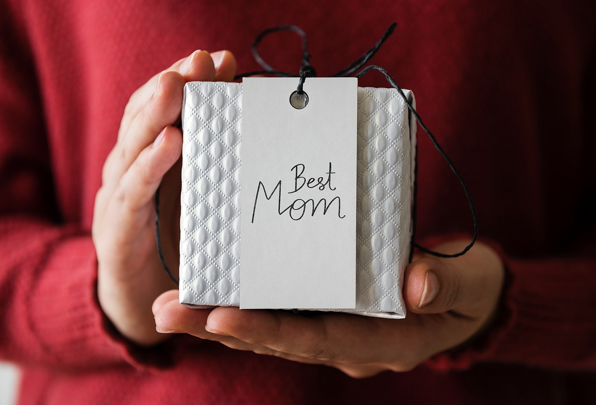 Woman holding present for her mom