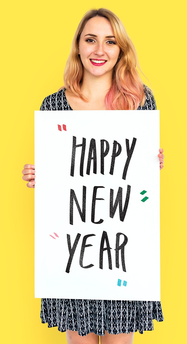 Cheerful woman holding a happy new year poster