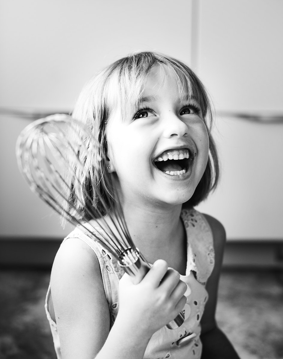 Little girl with a whisk