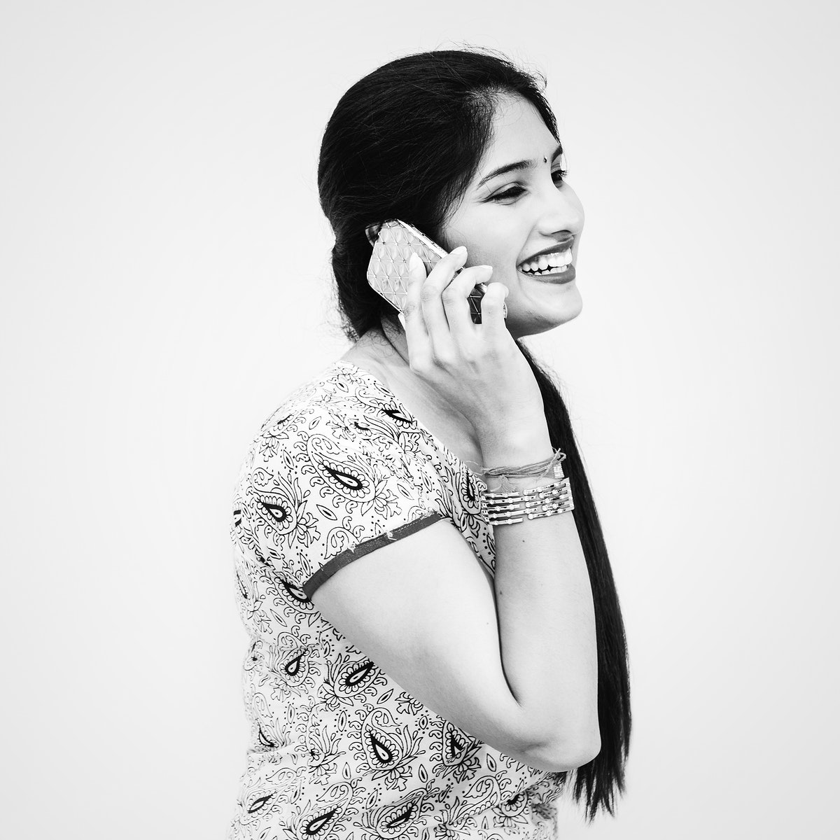 A young Indian woman talking on the phone
