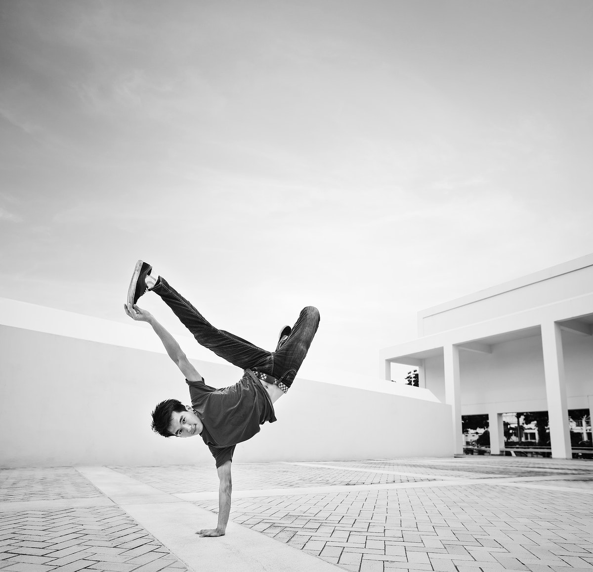 Young man break dancing at a rooftop