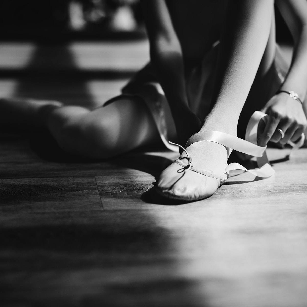 A girl getting ready to for a ballet lesson