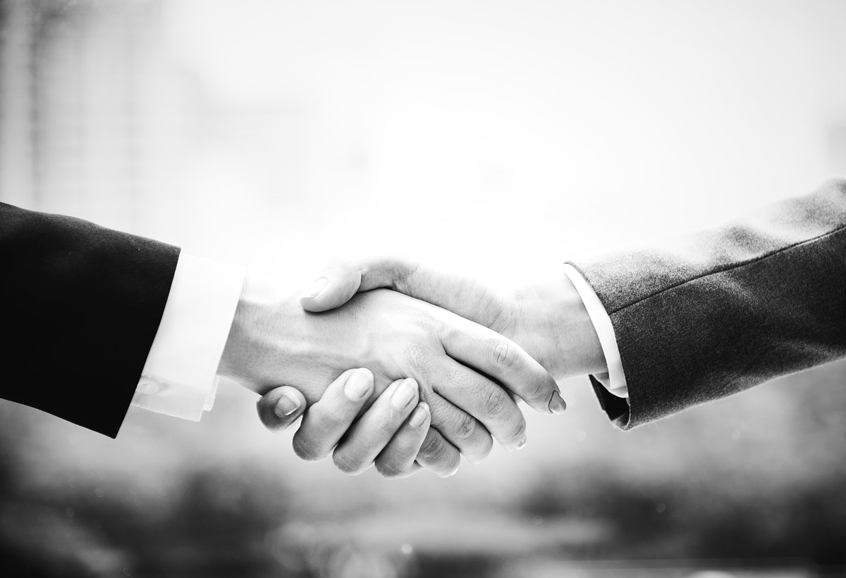 A close up of a business handshake