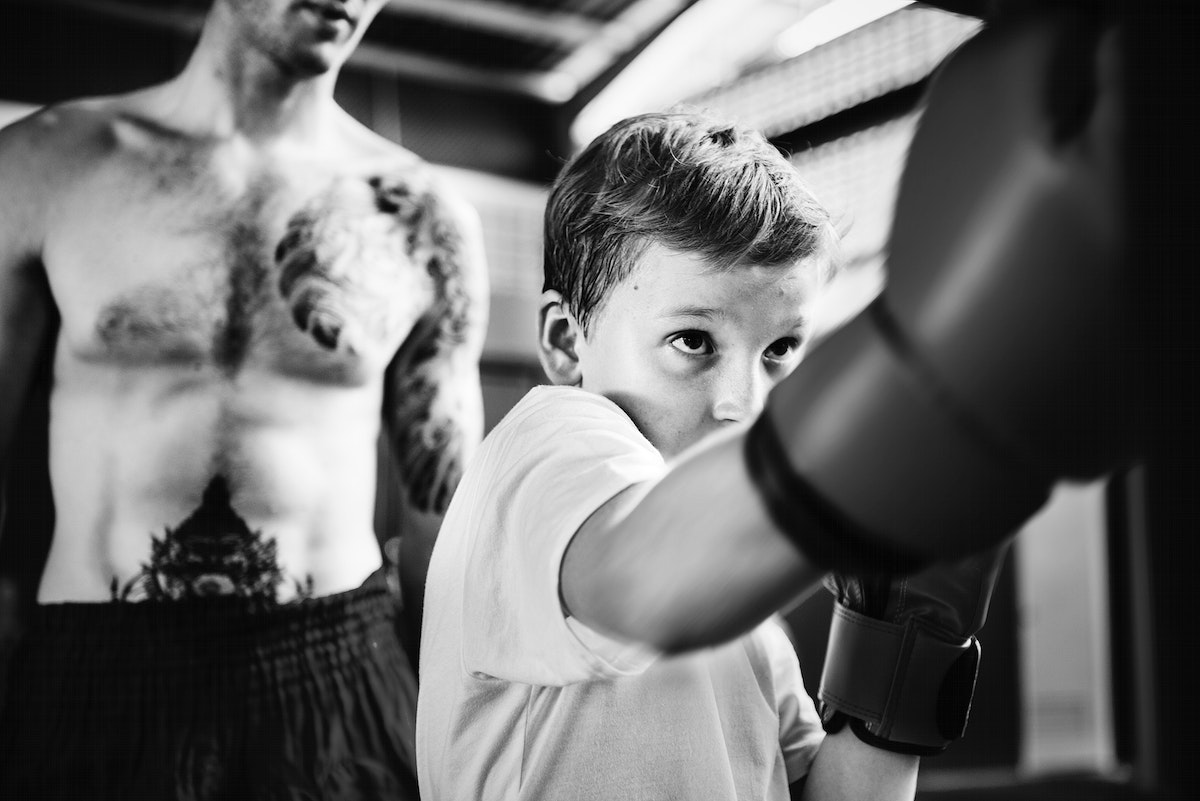 Young boy in boxing training
