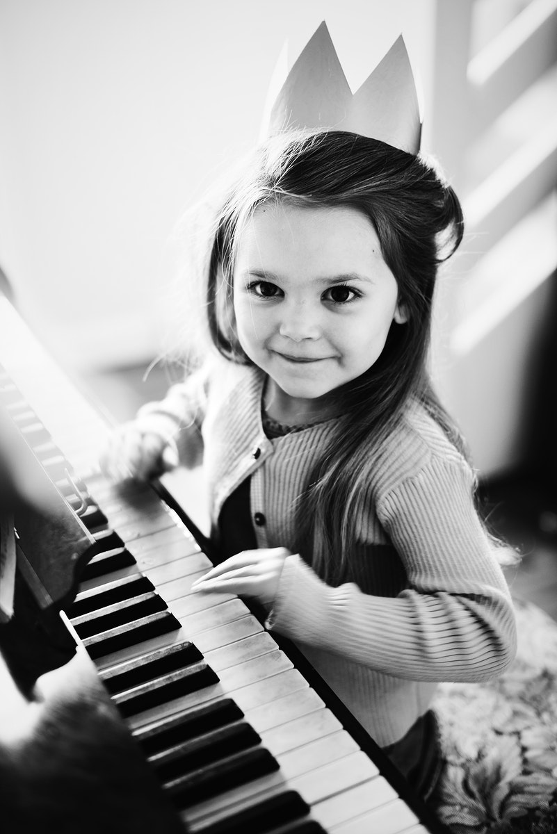Little Caucasian girl playing piano