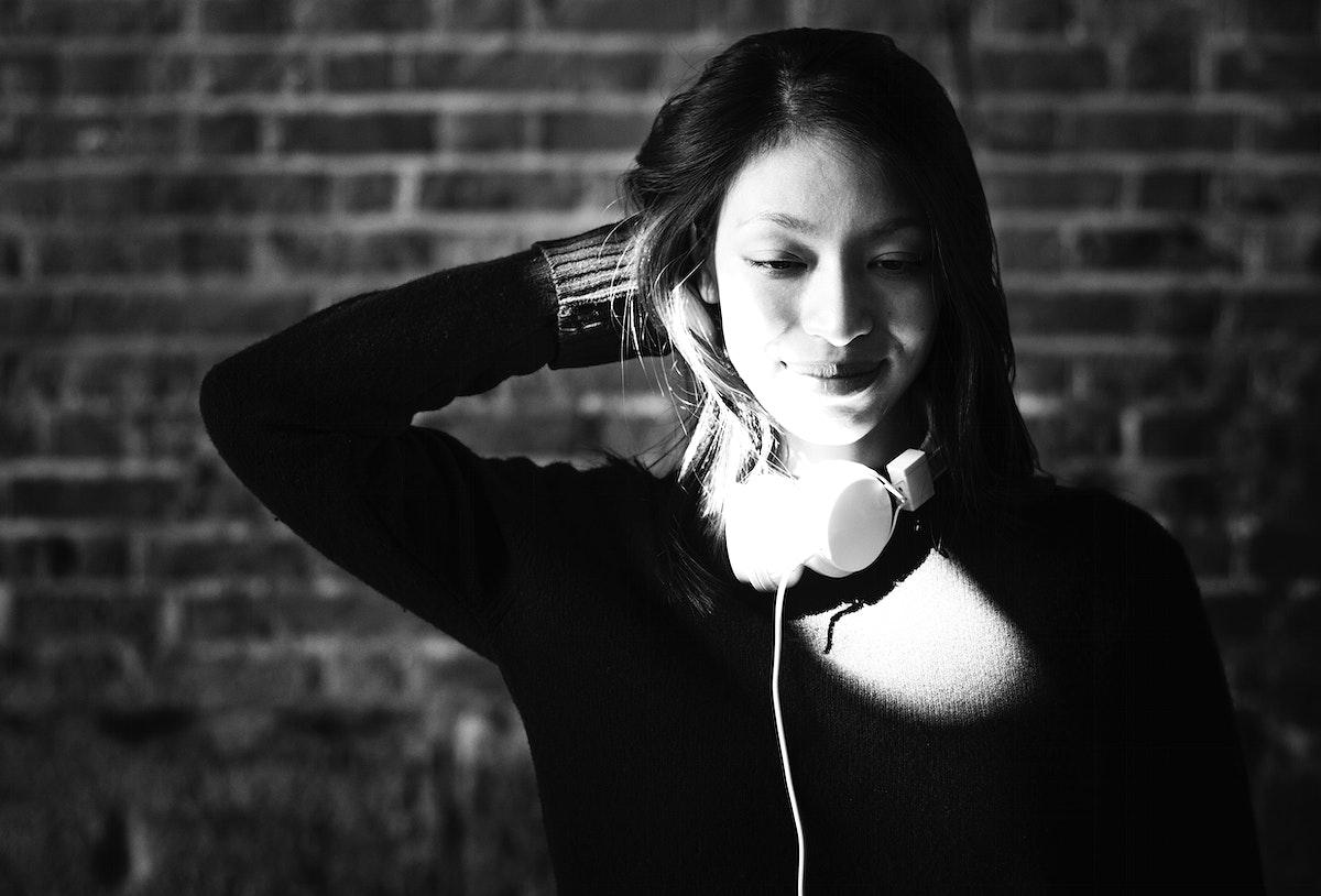 Beautiful Asian woman with headphones