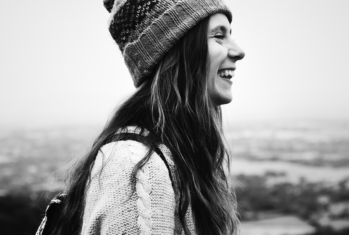 Side view of smiling Caucasian woman