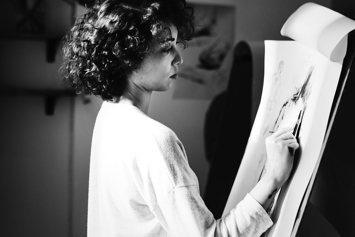 Woman drawing a picture by pencil