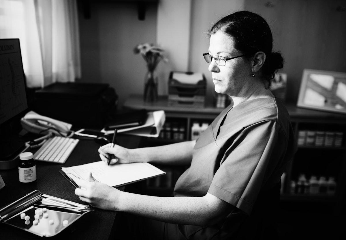 Female doctor writing a prescription
