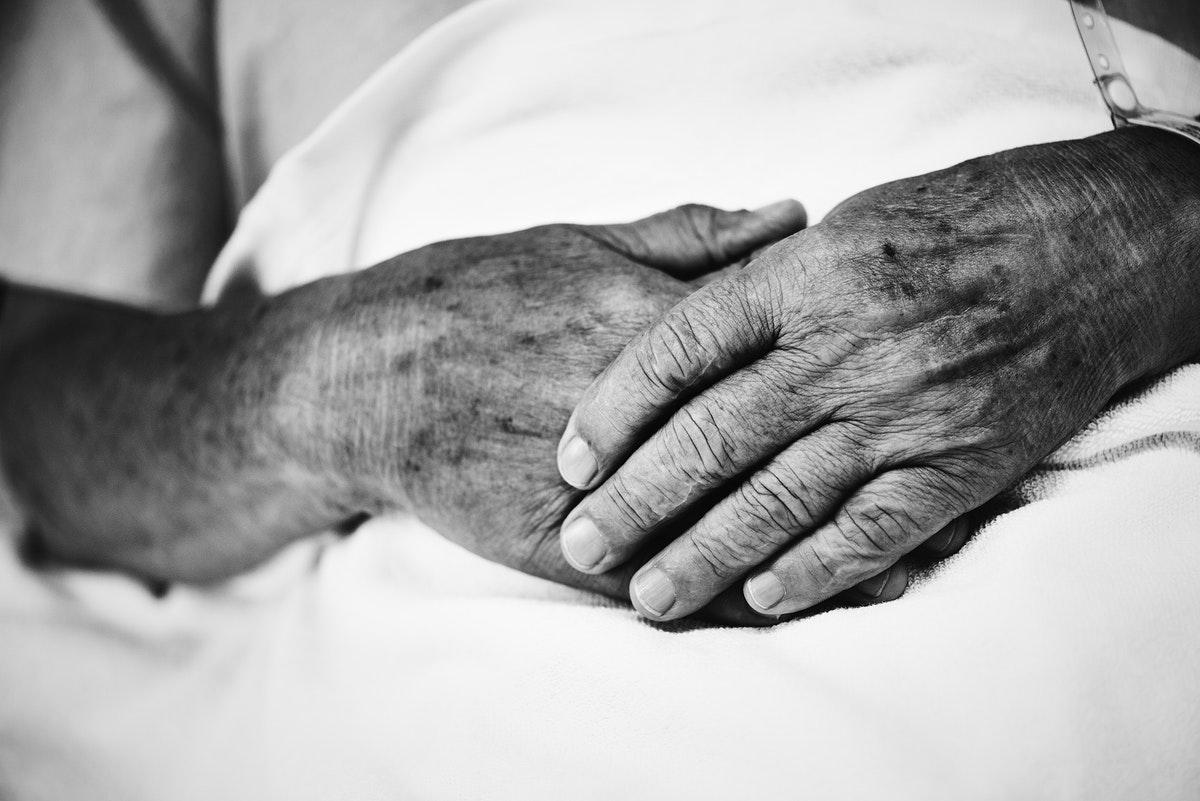 Hands of a sick old man