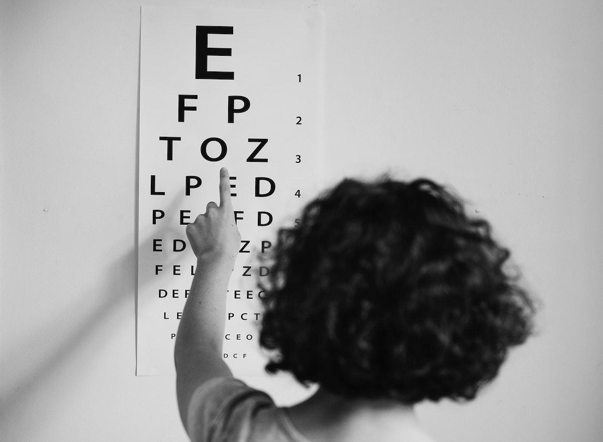 Young Caucasian girl getting an eye exam