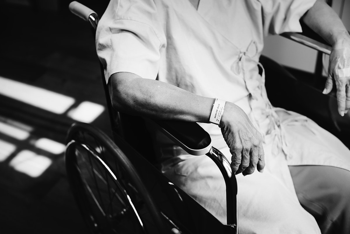 An old patient sitting in a wheelchair