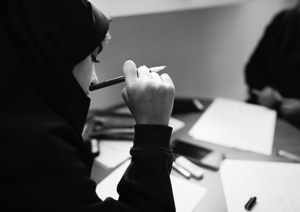 Young Muslim students learning in class