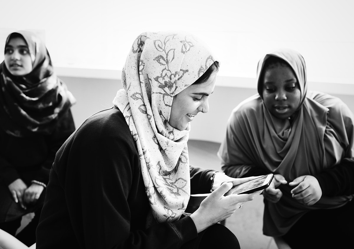 Group of Muslim students talking