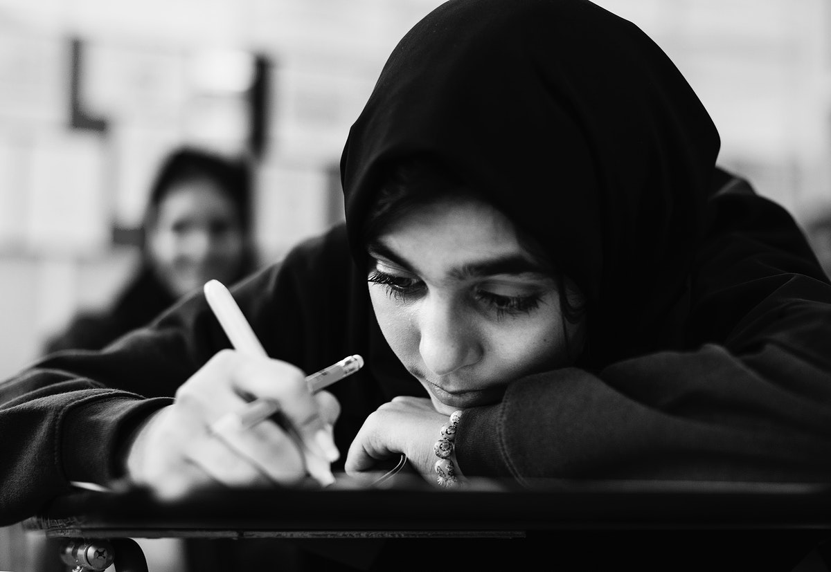 Young Muslim student studying in a classroom