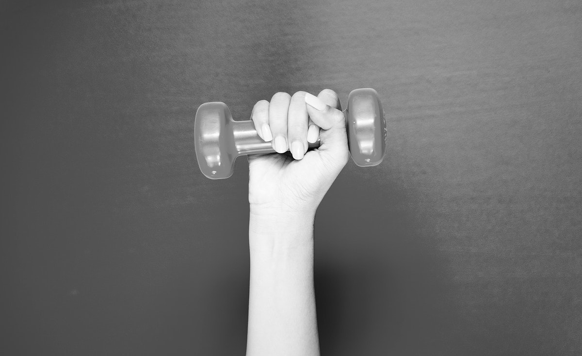 Closeup of hand holding a dumbbell