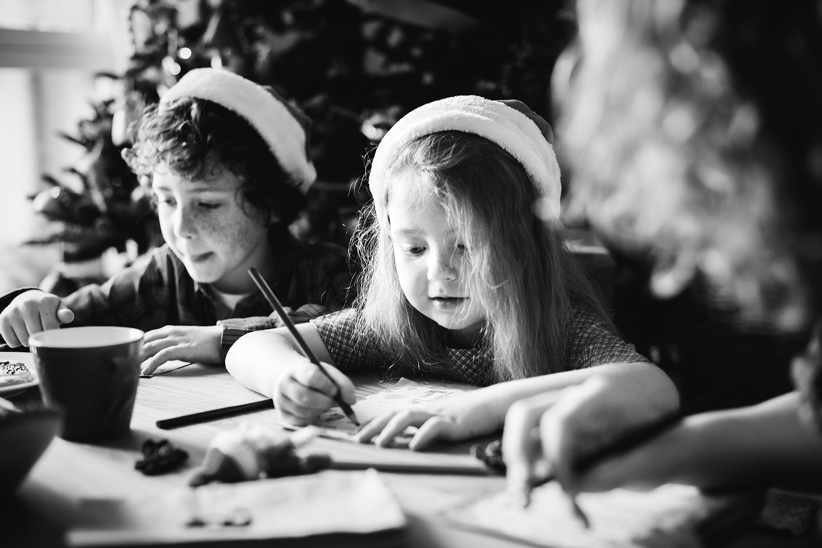 Kids enjoying a coloring book at a Christmas party