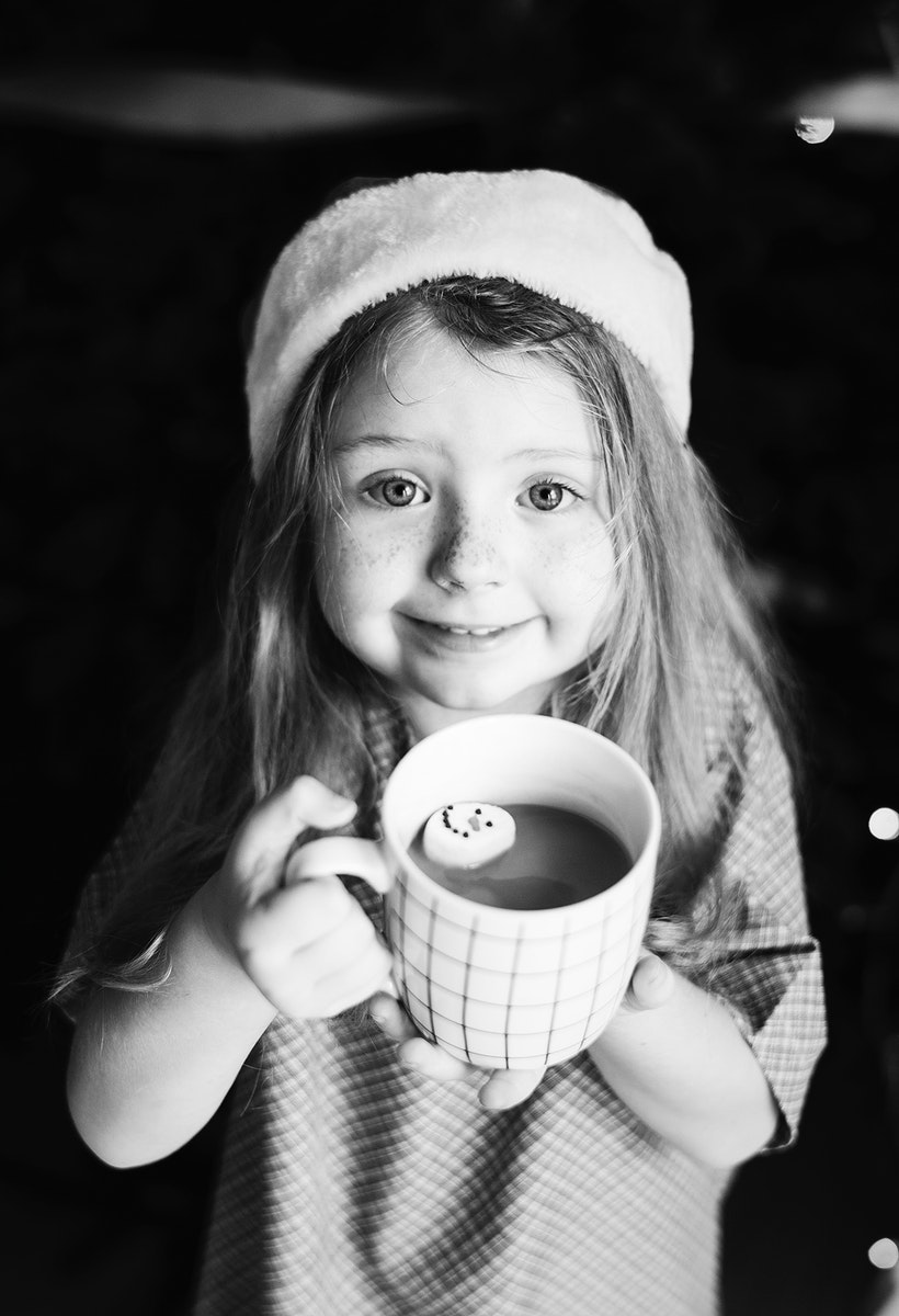 Little girl enjoying a mug of hot chocolate