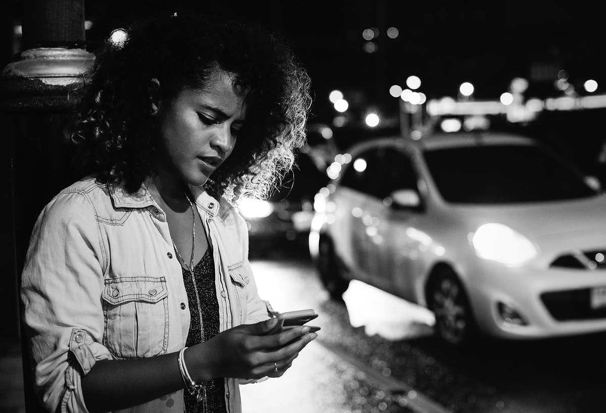 Woman using a mobile in the streets