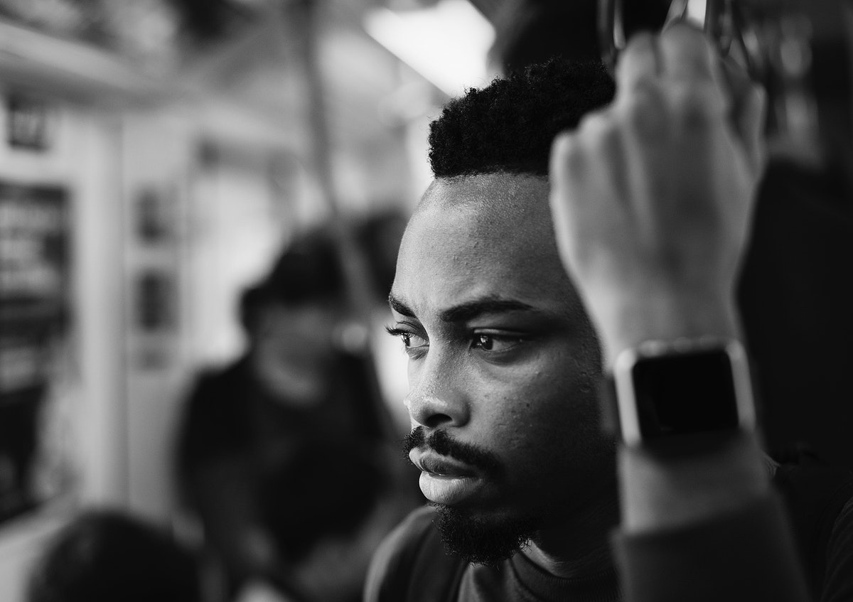 Young african man on a train