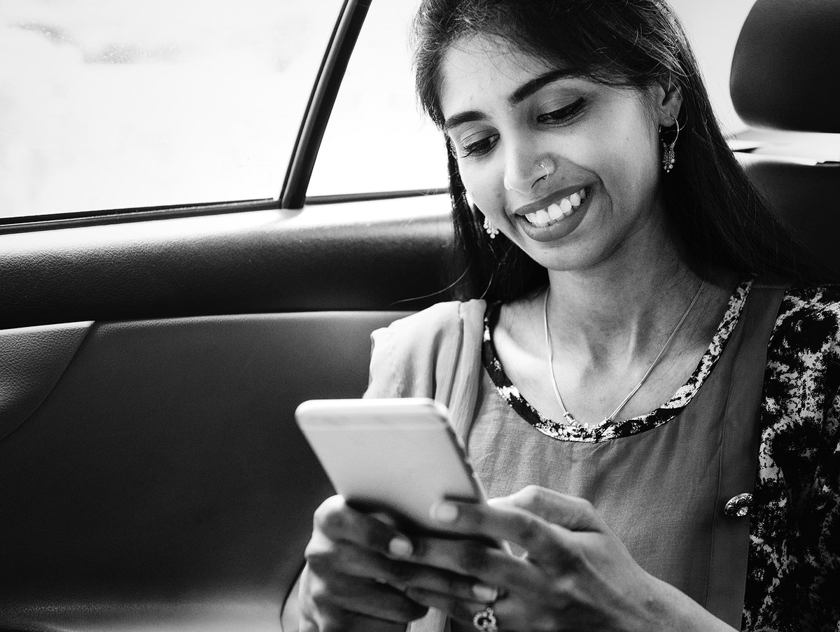 Indian woman using mobile phone