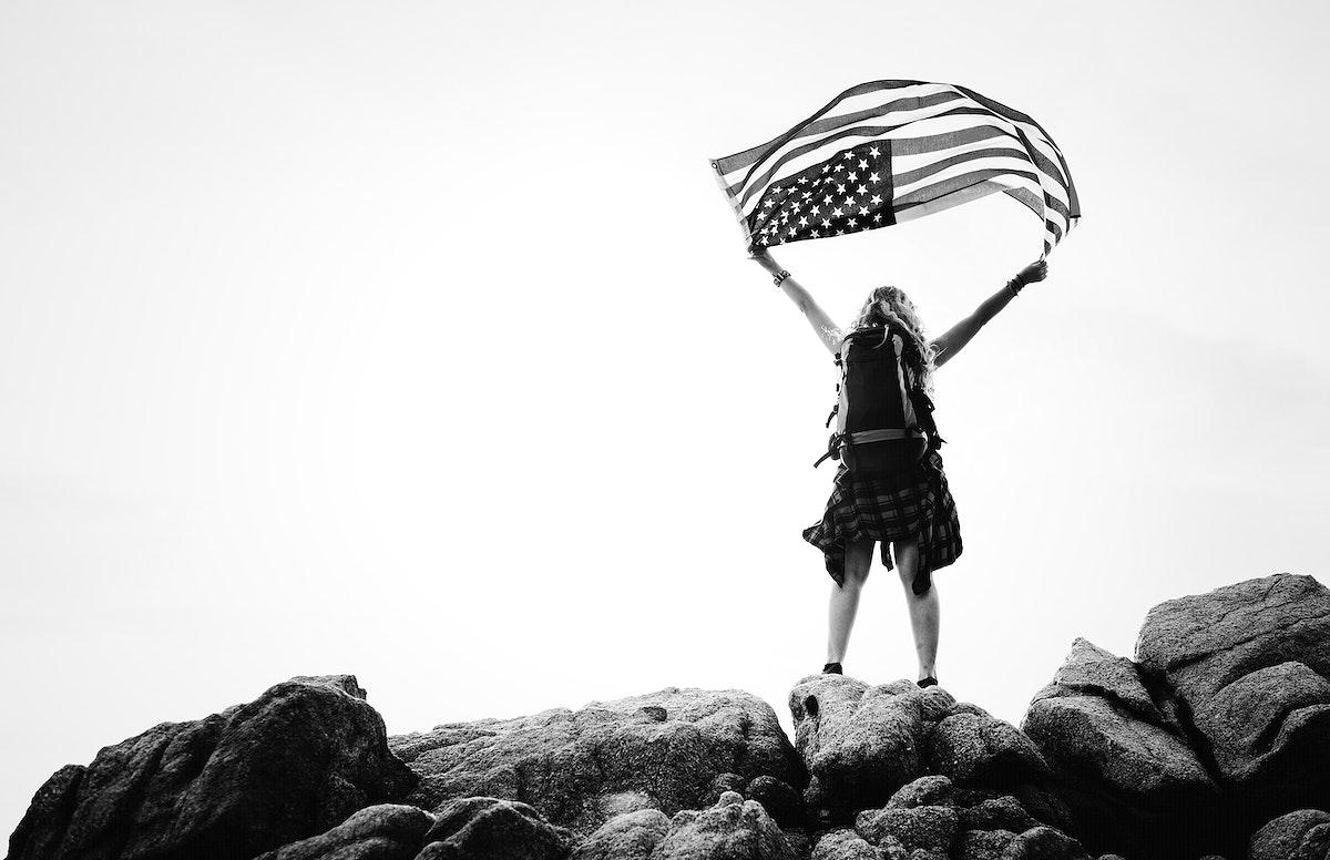Caucasian woman holding an American flag