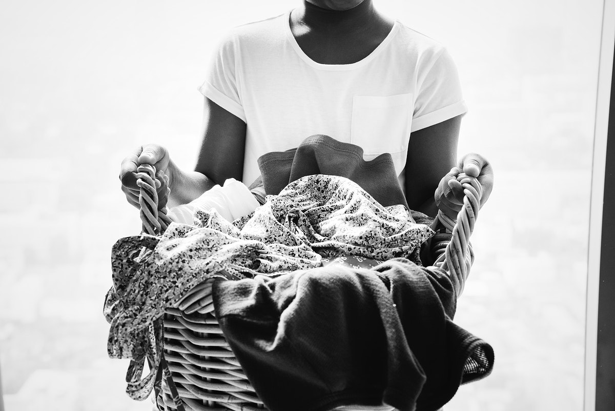 Young teen girl holding a laundry basket